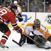 Philadelphia Flyers\' Ilya Bryzgalov (30), of Russia, makes a save on a shot by New Jersey Devils\' Steve Bernier (18) during the second period of Game 4 of a second-round NHL hockey Stanley Cup playoff series, Sunday, May 6, 2012, in Newark, N.J. (AP Photo/Julio Cortez)