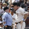 Photo - San Francisco Giants manager Bruce Bochy, right, argues with umpire Mike Muchlinski (76) after Juan Perez struck out against Colorado Rockies pitcher LaTroy Hawkins during the ninth inning of a baseball game in San Francisco, Sunday, June 15, 2014. Bochy was ejected by Muchlinski. The Rockies won 8-7. (AP Photo/Jeff Chiu)