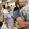 Brandon Weidner, of Ponca City, gets a hug from his father Ronald Weidner while his mother Lysetta Weidner (left) and grandmother Neva McGill look on as the troops return from Kuwait to Southwestern Oklahoma State University in Weatherford, Okla on Monday, August 10, 2009. Brandon Weidner\'s younger brother was killed in a car wreck while Brandon was overseas. By John Clanton, The Oklahoman