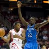 Houston\'s Kyle Lowry looks to pass while guarded by Thunder forward Jeff Green during Sunday\'s game. AP PHOTO