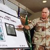 FILE - In this Jan. 27, 1991 file photo, U.S. Army Gen. Norman Schwarzkopf points to row of photos of Kuwait\'s Ahmadi Sea Island Terminal on fire after a U.S. attack on the facility. Schwarzkopf died Thursday, Dec. 27, 2012 in Tampa, Fla. He was 78. (AP Photo/Laurent Rebours, File)