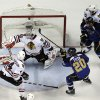 Photo - St. Louis Blues' Alexander Steen (20) scores the game-winning goal past Chicago Blackhawks goalie Corey Crawford and Niklas Hjalmarsson (4) as Blues' Steve Ott (29) and Blackhawks' Johnny Oduya (27), of Sweden, watch during the third overtime in Game 1 of a first-round NHL hockey Stanley Cup playoff series Thursday, April 17, 2014, in St. Louis. The Blues won 4-3 in triple overtime. (AP Photo/Jeff Roberson)