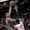 Milwaukee Bucks forward John Henson (31) shoots over Houston Rockets forward Thomas Robinson (0) during the first half of an NBA basketball game, Wednesday, Feb. 27, 2013 in Houston. (AP Photo/Bob Levey)