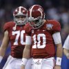 Photo - Alabama quarterback AJ McCarron (10) and offensive linesman Ryan Kelly (70) walk off the field after McCarron was sacked by Oklahoma during the first half of the Sugar Bowl NCAA college football game, Thursday, Jan. 2, 2014, in New Orleans. (AP Photo/Patrick Semansky)