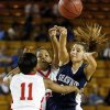 Shawnee\'s Bailey Taylor (20) passes away from Carl Albert\'s Gioya Carter (25) and Brianna Duchane (11) during a Class 5A girls high school basketball game in the semifinals of the state tournament at the Mabee Center in Tulsa, Okla., Friday, March 8, 2013. Shawnee defeated Carl Albert, 50-46, in overtime. Photo by Nate Billings, The Oklahoman