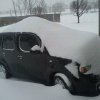 A snowed-in car in Midwest City. This is mostly drift.