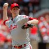 Photo - Philadelphia Phillies starting pitcher Kyle Kendrick throws during the first inning of a baseball game against the St. Louis Cardinals, Sunday, June 22, 2014, in St. Louis. (AP Photo/Scott Kane)
