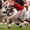 Chaz Nelson (37) brings down Brennan Clay (24) during the University of Oklahoma (OU) football team\'s annual Red and White Game at Gaylord Family/Oklahoma Memorial Stadium on Saturday, April 14, 2012, in Norman, Okla. Photo by Steve Sisney, The Oklahoman