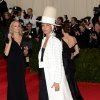 """Erykah Badu attends The Metropolitan Museum of Art\'s Costume Institute benefit gala celebrating """"Charles James: Beyond Fashion"""" on Monday, May 5, 2014, in New York. (Photo by Evan Agostini/Invision/AP)"""