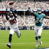 Photo -   Houston Texans wide receiver Andre Johnson (80) catches a pass for a touchdown as Miami Dolphins cornerback Sean Smith (24) defends in the second quarter of an NFL football game, Sunday, Sept. 9, 2012, in Houston. (AP Photo/Eric Gay)