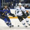 Photo - St. Louis Blues' Alexander Steen (20) and San Jose Sharks' Logan Couture (39) chase the puck during the first period of an NHL hockey game Tuesday, Oct. 15, 2013, in St. Louis. (AP Photo/Bill Boyce)