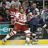 Mike Burgoyne of the Oklahoma City Blazers hits Steve Simoes of the Laredo Bucks during the first period of the CHL hockey game at the Ford Center in Oklahoma City, Friday, Jan. 18, 2008. BY BRYAN TERRY, THE OKLAHOMAN