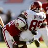 Oklahoma\'s Ryan Broyles (85) is hit by Stanford\'s Johnson Bademosi (27) that forced a fumble on a punt reception by Broyles during the second half of the Brut Sun Bowl college football game between the University of Oklahoma Sooners (OU) and the Stanford University Cardinal on Thursday, Dec. 31, 2009, in El Paso, Tex. Photo by Chris Landsberger, The Oklahoman