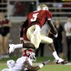 Florida\'s EJ Manuel (3) leaps over Oklahoma\'s Demontre Hurst (6) during a college football game between the University of Oklahoma (OU) and Florida State (FSU) at Doak Campbell Stadium in Tallahassee, Fla., Saturday, Sept. 17, 2011. Photo by Bryan Terry, The Oklahoman