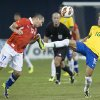 Brazil\'s Neymar, right, battles for the ball with Chile\'s Gary Medel during the second half of their international friendly soccer match, Tuesday, Nov. 19, 2013 in Toronto. (AP Photo/The Canadian Press, Chris Young)