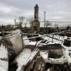 A fire-scorched landscape of Breezy Point is shown after a Nor\'easter snow, Thursday, Nov. 8, 2012 in New York. The beachfront neighborhood was devastated during Superstorm Sandy when a fire pushed by the raging winds destroyed many homes. (AP Photo/Mark Lennihan)