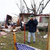 Brian Bernard of Petal, Miss., walks behind a makeshift memorial in front of his tornado damaged home Tuesday, Feb. 12, 2013. The home was one of several destroyed by Sunday\'s tornado touchdown. following the Sunday afternoon tornado that caused damage throughout several communities in mid-state. (AP Photo/Rogelio V. Solis)