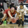 Louisville\'s Bria Smith, left, battles Purdue\'s April Wilson for a loose ball during the second half of their second round game in the women\'s NCAA college basketball tournament in Louisville, Ky., Tuesday March 26, 2013. Louisville defeated Purdue 76-63. (AP Photo/Timothy D. Easley)
