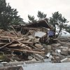 A beachfront house is completely destroyed in the aftermath of a superstorm Sandy, Tuesday, Oct. 30, 2012, in Coney Island\'s Sea Gate community in New York. (AP Photo/Bebeto Matthews) ORG XMIT: NYBM114
