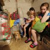 Ginger Short, daughter Tori Short, 4yr, and Morgaine Gooch, 14yr, ride out tornado warnings in a storm shelter in NW Oklahoma City, Friday May 31, 2013.Photo By Steve Gooch, The Oklahoman