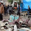 Photo - Iraqis inspect the aftermath of a late-night bombing at a cafe in Bayaa neighborhood, southwestern Baghdad, Iraq, Thursday, Nov. 21, 2013. Officials in Iraq say scores have been killed in a wave of bombings on Wednesday, Nov. 20, 2013 mainly in Shiite commercial areas in and near the capital. (AP Photo/Karim Kadim)