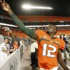 Photo - Miami quarterback Jacory Harris throws his sweatbands into the stands after Miami defeated Georgia Tech 33-17 in an NCAA college football game Thursday, Sept. 17, 2009, in Miami. (AP Photo/Hans Deryk) ORG XMIT: LSS114