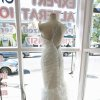 Photo - In this July 28, 2014 photo, the dress Nicole Pagliaro wore for her wedding is displayed in the window of a dry cleaner in the Staten Island borough of New York where Pagliaro discovered it long after assuming it had been lost to Superstorm Sandy. The shop she brought it to for cleaning was destroyed by the storm, but two weeks ago Pagliaro took a different route to work and spotted it in the window of the dry cleaner's new store. (AP Photo/Staten Island Advance, Hilton Flores)