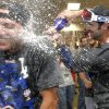 Photo - Los Angeles Dodgers' Scott Van Slyke, right, sprays a teammate after the Dodgers clinched the NL West title with a 7-6 win over the Arizona Diamondbacks in a baseball game Thursday, Sept. 19, 2013, in Phoenix. (AP Photo/Ross D. Franklin)