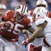 Wisconsin running back Melvin Gordon (25) is tackled by Nebraska cornerback Ciante Evans (17) and other defenders during the first half of the Big Ten championship NCAA college football game Saturday, Dec. 1, 2012, in Indianapolis. (AP Photo/Michael Conroy)