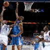 Oklahoma City\'s Russell Westbrook shoots over Tyson Chandler of New Orleans as Kevin Durant watches during the NBA basketball game between the Oklahoma City Thunder and the New Orleans Hornets at the Ford Center in Oklahoma City on Friday, Nov. 21, 2008. BY BRYAN TERRY, THE OKLAHOMAN