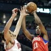 Philadelphia 76ers forward Thaddeus Young, right, shoots over Chicago Bulls center Joakim Noah during the first half of an NBA basketball game in Chicago on Saturday, Dec. 1, 2012. (AP Photo/Nam Y. Huh)
