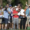 Photo - Golfer Tiger Woods hits from out of bounds on the third hole during the Pro-Am round of the Honda Classic golf tournament, Wednesday, Feb. 26, 2014 in Palm Beach Gardens, Fla. (AP Photo/Wilfredo Lee)