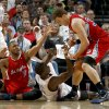 Oklahoma City\'s Serge Ibaka (9) fights for the ball with Los Angeles Clippers\' Eric Gordon (10) and Blake Griffin (32) during the NBA basketball game between the Oklahoma City Thunder and the Los Angeles at the Oklahoma City Arena, Wednesday, April 6, 2011. Photo by Bryan Terry, The Oklahoman