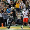 Baylor\'s Nick Florence (11) rushes for a touchdown past Oklahoma State\'s Shamiel Gary (7) in the second quarter during a college football game between the Oklahoma State University Cowboys (OSU) and the Baylor University Bears at Floyd Casey Stadium in Waco, Texas, Saturday, Dec. 1, 2012. Photo by Nate Billings, The Oklahoman
