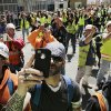 FILE - In this May 2, 2013 file photo, construction workers watch and take photos with their phones as the final piece of spire is hoisted to the roof of One World Trade Center in New York. (AP Photo/Mark Lennihan)