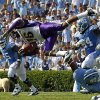 North Carolina\'s Eric Ebron, bottom right, upends James Madison\'s Dean Marlowe (16) during the first half of an NCAA college football game in Chapel Hill, N.C., Saturday, Sept. 3, 2011. North Carolina\'s Cam Holland (65) and Jonathan Cooper (64) assist. (AP Photo/Gerry Broome)