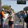 McKale Davis crosses the finish line as the female winner in the Oklahoma City Memorial Marathon in Oklahoma City, Sunday, April 28, 2013, By Paul Hellstern, The Oklahoman