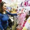 Stephanie Winburn shops for baby clothes with her 3-month-old daughter, Serena, at Once Upon A Child, 13801 N Pennsylvania. Steve Gooch - The Oklahoman
