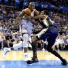 Oklahoma City \'s Serge Ibaka (9) derives past Utah\'s Jeremy Evans (40) during the NBA game between the Oklahoma City Thunder and the Utah Jazz at the Chesapeake Energy Arena, Sunday, March 30, 2014, in Oklahoma City. Photo by Sarah Phipps, The Oklahoman