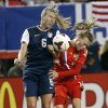 Photo - United States' Whitney Engen (6) andRussia's Ekaterina Terekhova try to head the ball during the first half of an exhibition soccer match Thursday, Feb. 13, 2014, in Atlanta. (AP Photo/John Bazemore)