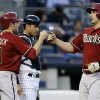 Arizona Diamondbacks\' A.J. Pollock (11) greets Paul Goldschmidt at the plate after Goldschmidt\'s first-inning, two-run, home run off New York Yankees starting pitcher CC Sabathia in a baseball game at Yankee Stadium in New York, Wednesday, April 17, 2013. Yankees catcher Francisco Cervelli looks on at rear. (AP Photo/Kathy Willens)