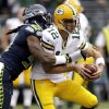 Photo -   Seattle Seahawks defensive end Bruce Irvin, left, sacks Green Bay Packers quarterback Aaron Rodgers (12) in the first half of an NFL football game, Monday, Sept. 24, 2012, in Seattle. (AP Photo/Ted S. Warren)