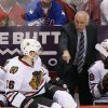 Photo - Chicago Blackhawks' Joel Quenneville shouts instructions to his players, including Marcus Kruger (16), of Sweden, during the second period in an NHL hockey game against the Phoenix Coyotes, Friday Feb. 7, 2014, in Glendale, Ariz. (AP Photo/Ross D. Franklin)