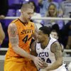 Oklahoma State\'s Philip Jurick (44) defends as TCU \'s Adrick McKinney (24) looks for an opening to the basket in the first half of an NCAA basketball game on Wednesday, Feb. 27, 2013, in Fort Worth, Texas. (AP Photo/Tony Gutierrez) ORG XMIT: TXTG104
