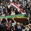 Muslim Brotherhood and Egyptian President Morsi supporters carry a body one of six victims who were killed during Wednesday\'s clashes during their funeral outside Al Azhar mosque, the highest Islamic Sunni institution, Friday, Dec. 7, 2012. During the funeral, thousands Islamist mourners chanted,