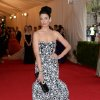"""Jessica Pare attends The Metropolitan Museum of Art\'s Costume Institute benefit gala celebrating """"Charles James: Beyond Fashion"""" on Monday, May 5, 2014, in New York. (Photo by Evan Agostini/Invision/AP)"""