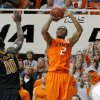 Oklahoma State\'s Le\'Bryan Nash (2) shoots a basket as the crowd watches during an NCAA college basketball game between the Oklahoma State University Cowboys (OSU) and the Missouri Tigers (MU) at Gallagher-Iba Arena in Stillwater, Okla., Wednesday, Jan. 25, 2012. Photo by Bryan Terry, The Oklahoman