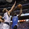 Oklahoma City\'s James Harden (13) goes to the basket beside Dirk Nowitzki (41) of Dallas during game 5 of the Western Conference Finals in the NBA basketball playoffs between the Dallas Mavericks and the Oklahoma City Thunder at American Airlines Center in Dallas, Wednesday, May 25, 2011. Photo by Bryan Terry, The Oklahoman