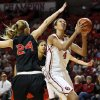 Oklahoma\'s Nicole Griffin (4) shoots next to Cal State Northridge\'s Marta Masoni (24) in the first half during a women\'s college basketball game between the University of Oklahoma (OU) and Cal State Northridge at the Lloyd Noble Center in Norman, Okla., Saturday, Dec. 29, 2012. Photo by Nate Billings, The Oklahoman