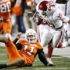 Oklahoma\'s Dominique Franks (15) is tripped up by Oklahoma State\'s Zac Robinson (11) after Franks intercepted Robinson\'s pass during the first half of the college football game between the University of Oklahoma Sooners (OU) and Oklahoma State University Cowboys (OSU) at Boone Pickens Stadium on Saturday, Nov. 29, 2008, in Stillwater, Okla. STAFF PHOTO BY CHRIS LANDSBERGER